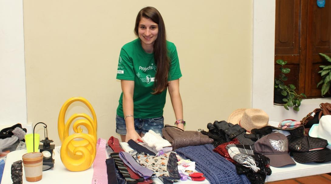 A Projects Abroad Business intern spend time at a beneficiary's small stall as part of her internship in Mexico.